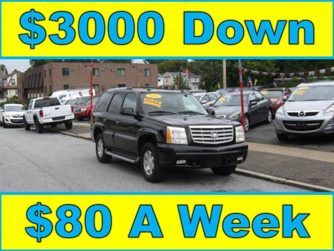 2004 Black /Gray Cadillac Escalade AWD (1GYEK63N14R) with an 6.0L V8 OHV 16V engine, 4-Speed Automatic Overdrive transmission, located at 577 Chester Pike, Prospect Park, PA, 19076, (610) 237-1015, 39.886154, -75.302338 - Photo #0