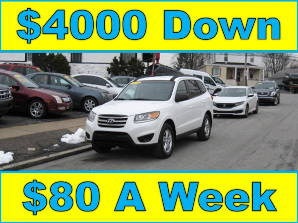 2012 White /Gray Hyundai Santa Fe GLS 2.4 4WD (5XYZGDAB1CG) with an 2.4L L4 DOHC 16V engine, 6-Speed Automatic transmission, located at 577 Chester Pike, Prospect Park, PA, 19076, (610) 237-1015, 39.886154, -75.302338 - Photo #0