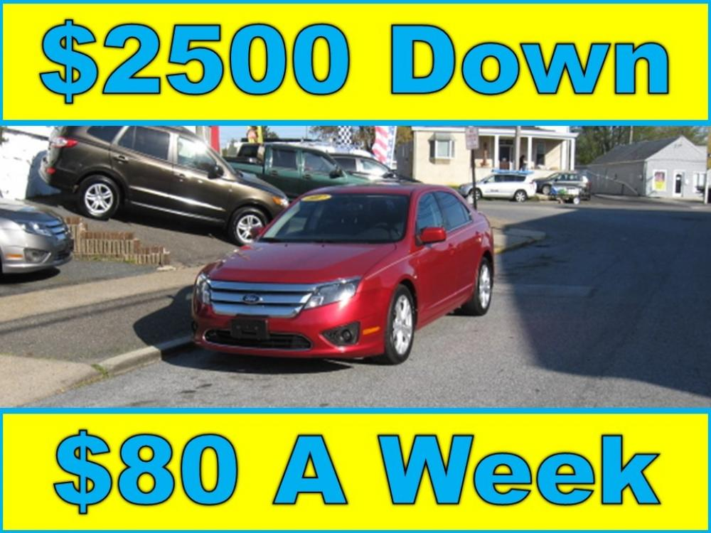 2012 Red /Gray Ford Fusion SE (3FAHP0HA8CR) with an 2.5L L4 DOHC 16V engine, Automatic transmission, located at 577 Chester Pike, Prospect Park, PA, 19076, (610) 237-1015, 39.886154, -75.302338 - Photo #1