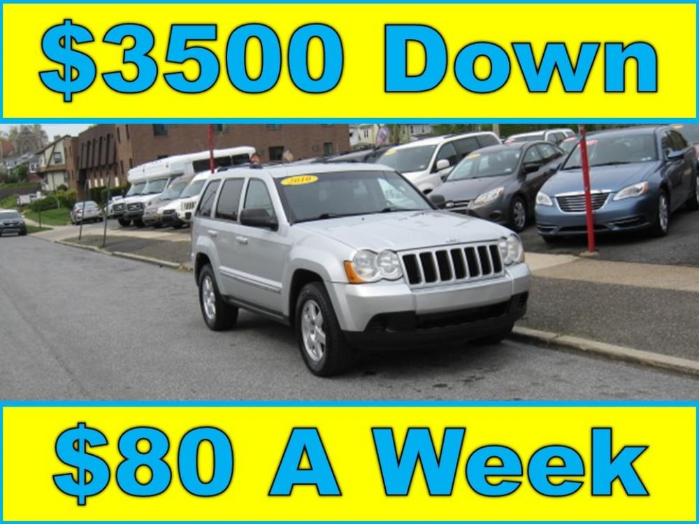 2010 Silver /Gray Jeep Grand Cherokee Laredo 4WD (1J4PR4GK2AC) with an 3.7L V6 SOHC 12V engine, 5-Speed Automatic transmission, located at 577 Chester Pike, Prospect Park, PA, 19076, (610) 237-1015, 39.886154, -75.302338 - Photo #0