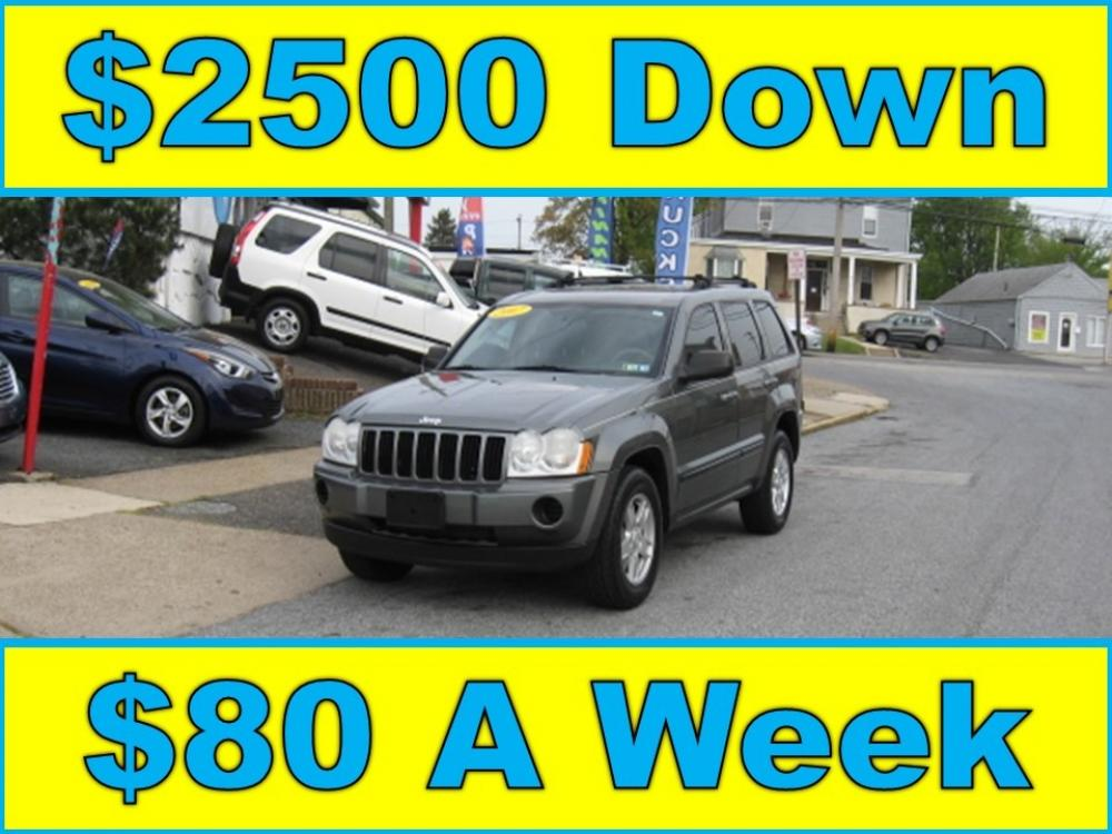 2007 Gray /Gray Jeep Grand Cherokee Laredo 4WD (1J8GR48KX7C) with an 3.7L V6 SOHC 12V engine, 5-Speed Automatic Overdrive transmission, located at 577 Chester Pike, Prospect Park, PA, 19076, (610) 237-1015, 39.886154, -75.302338 - Photo #0