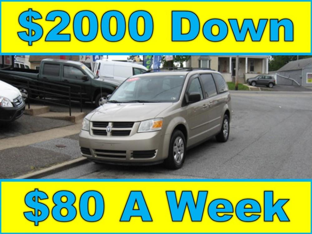 2009 Gold /Tan Dodge Grand Caravan SE (2D8HN44E39R) with an 3.3L V6 OHV 12V engine, 4-Speed Automatic Overdrive transmission, located at 577 Chester Pike, Prospect Park, PA, 19076, (610) 237-1015, 39.886154, -75.302338 - Photo #0